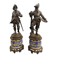 Pair of Continental Cast Iron Soldier Statues Mounted on Majolica Bases