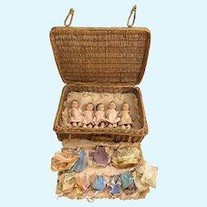 Set of Five Madame Alexander Dionne Quintuplets Composition Dolls with Rattan Suitcase circa 1930's