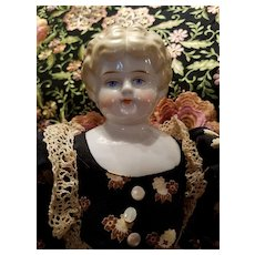Antique Blonde China with Turned Head