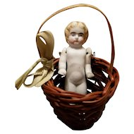 Antique Bisque Doll in Basket