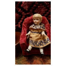 Antique All Bisque Girl with Molded Blonde Hair