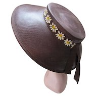 Adorable Straw Hat in Chocolate Brown and Hand Painted Daisy Band Pierce New York Consumer Action Label