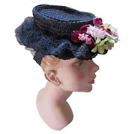 Sweet Navy Straw Hat with Wavy Brim and Floral Spray in Lavender and Purple Janet Models 1940 1950 Era
