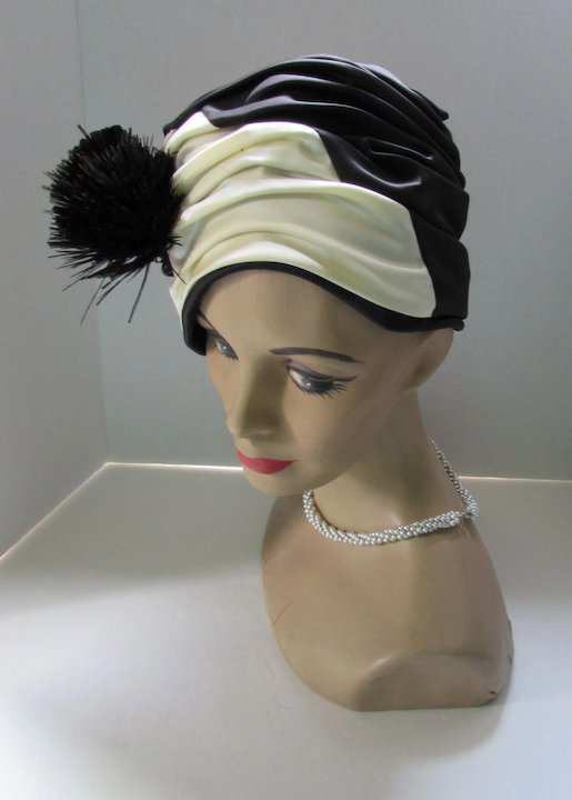 e8c39b414594c Dramatic Turban Style Hat in Black and Cream Satin with Fan Feather  Decoration