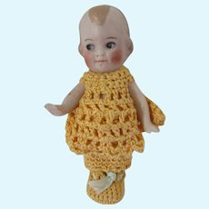 Sweet Tiny Bisque Doll in Marigold Crochet Outfit