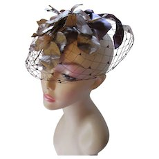 Fascinating Whimsy Hat in Shiny Bronze Leaves Milk Chocolate Bow and Deep Brown Net Veil