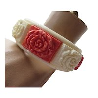 Bangle Bracelet with Raised Floral Panels in Cream and Pumpkin Orange Mid Century Plastic