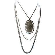 Matching Etched Pendant and Earrings on Three Chains Silver Tone