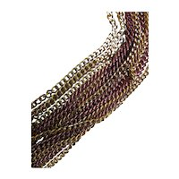 Les Bernard Multi Strand Necklace in Shades of Gold and Gun Metal