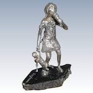 Metal Sculpture Of Girl Holding a Doll Signed J. Boylan
