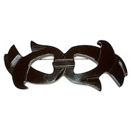 Deeply Carved Brown Bakelite Ribbon Brooch