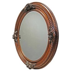 Oval Bevelled Mirror with Carved Frame