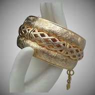 Gold Toned Repousse Bracelet Braided Trim