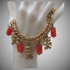 Napier Oriental Gold Toned Charm Bracelet