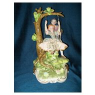 Porcelain Figurine Boy & Girl on Swing