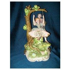 Porcelain Figurine Boy & Girl on Swing