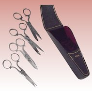 Four Scissors In A Leather Case