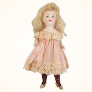 All Bisque Doll With Long Black Stockings