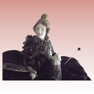 Art Deco Pincushion Lady On Cushion With Arms Away and Legs Holding A Mirror and a Beaded Tassel