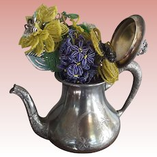 Beaded Flowers In A Silver Plate Teapot