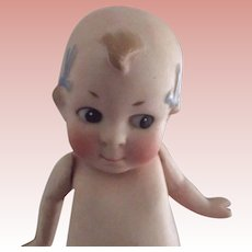 Kewpie Type Doll With Bows
