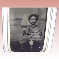 Tintype of  a Child and Her Doll