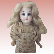Solid Dome Doll With A Blue and A Brown Eye All Original
