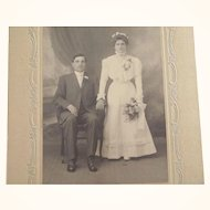 Serious Victorian/Edwardian  Bride and Groom Photo