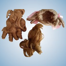Three Vintage Synthetic Doll Wigs
