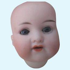 A.M. 990 Baby Head