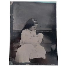 Tintype Photo of A Girl and Her Doll