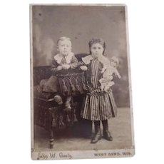 Cabinet Card of Two Children One With Doll