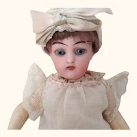 Small Fully Jointed Doll With Molded Shoes