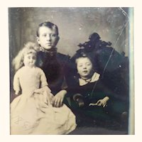 Tintype Of Two Children and A Large Doll