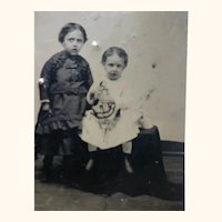 Tintype of Two Children and a China Doll