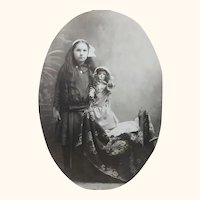 Early Postcard Photo of A Girl and Her Doll