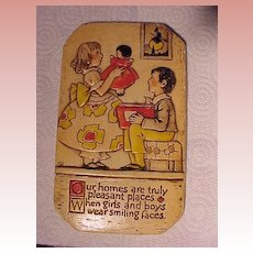 Endearing Chalkware Plaque With Child and Doll