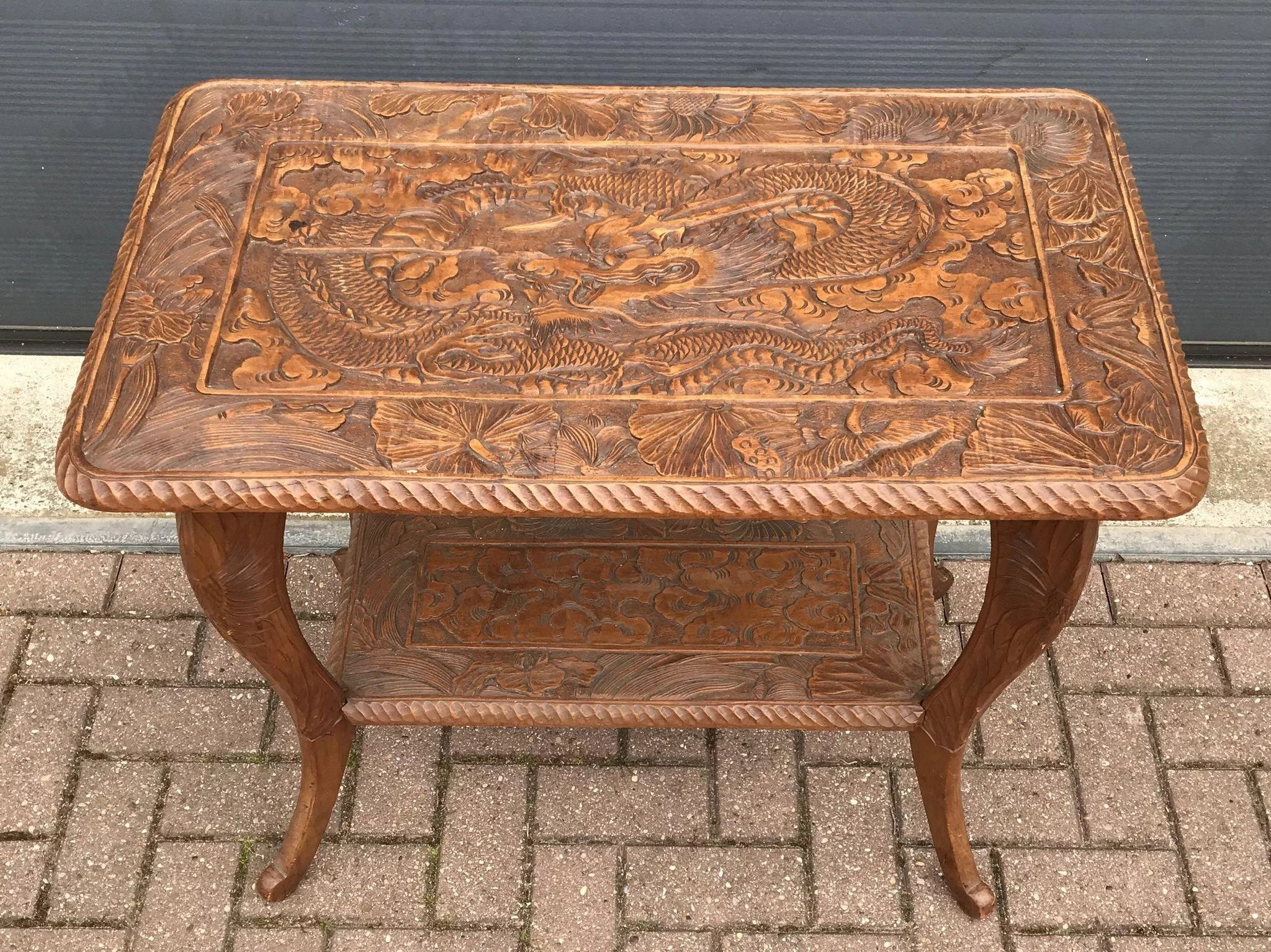 Art nouveau carved wood table with sunflowers and dragon