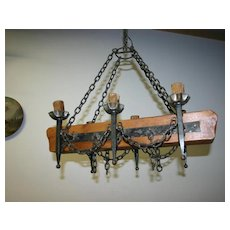 An old French wooden / wrought-iron castle chandelier