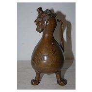 An Early Bronze Figural Oil Lamp