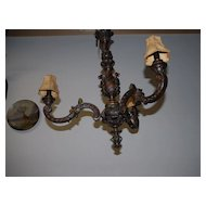 An Italian Carved Wood 3 light Chandelier