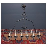 A Huge French Wooden/Wrought-iron 12 light Castle Chandelier