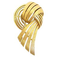 Trifari Gold Tone Swirled Ribbon Brooch