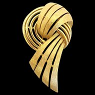Trifari Gold Tone Swirled Ribbon Brooch