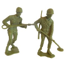 Two  Green Plastic Toy Soldiers
