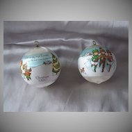 Two 1980 Joan Walsh Anglund Christmas Satin Ball Ornaments
