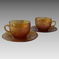 Two Indiana Tiara Exclusives Amber Cups and Saucer
