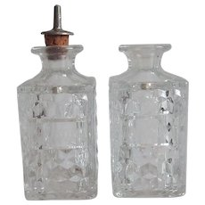 Two Fostoria American Crystal Bitter Bottles