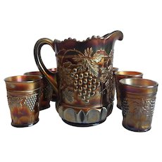 Northwood Carnival Glass Amethyst Pitcher And Six Tumblers