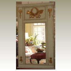 Trumeau mirror with horn and torch